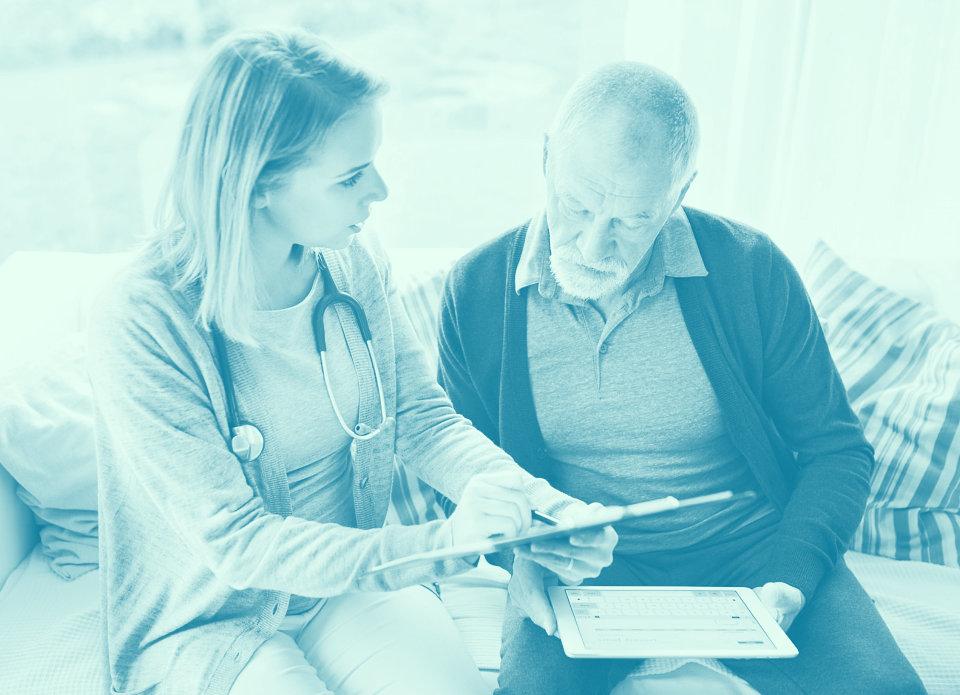 caregiver showing a medical test result to a senior man